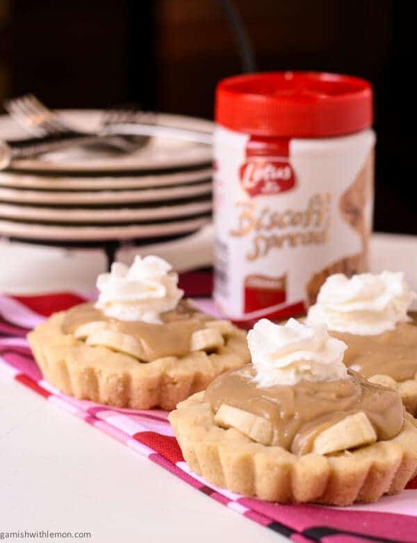 Rich and creamy and full of banana-these Biscoff Banana Tarts are the perfect crowd pleasing dessert!
