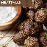 meatballs on a plate with dipping sauce