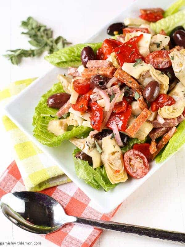 Antipasto Salad with Red Wine Vinaigrette on a white plate