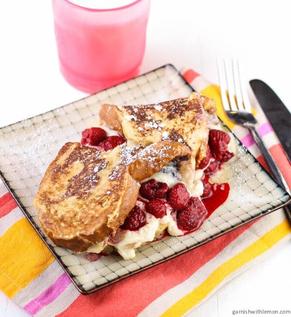 Mascarpone and Raspberry Stuffed French Toast on plate.