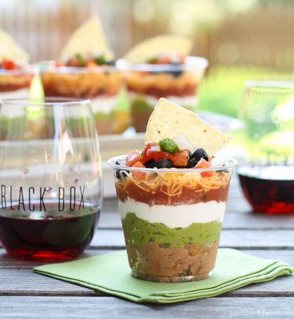 Make-ahead Individual Seven Layer Dips are perfect for parties. No more wondering if you have enough for everyone.