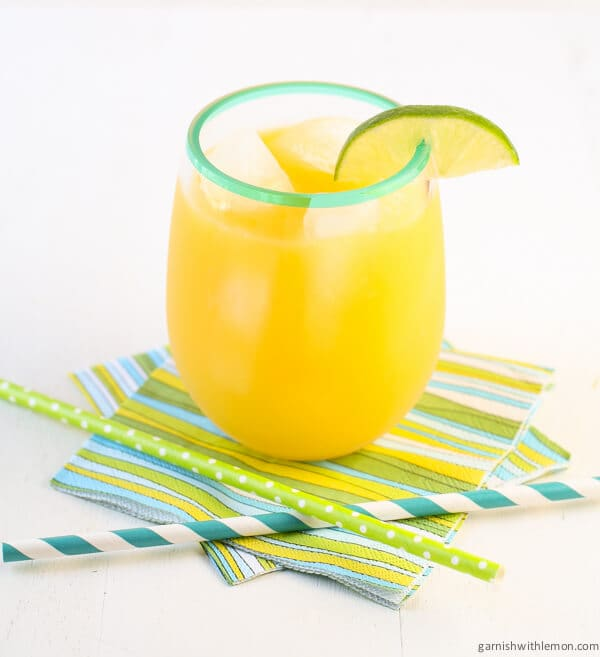 Mango Ginger Agua Fresca in glass with straws.