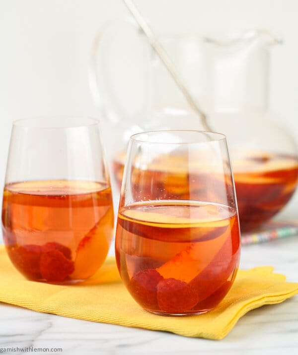 This recipe for Peach Rosé Sangria is great for groups and parties because everything is done in advance.