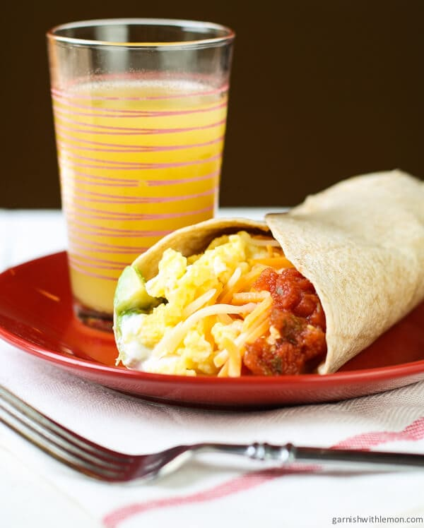 This Easy Breakfast Burrito is packed with flavor and protein making it a quick and simple way to start a busy school day.