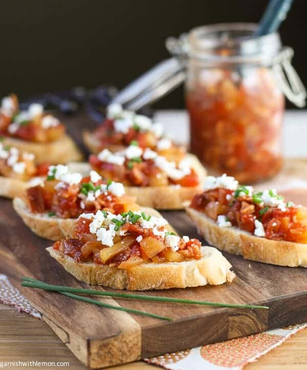 This Crostini with Savory Tomato, Bacon & Apple Jam is a fantastic fall or holiday appetizer. Make the jam ahead of time so assembly is a snap!