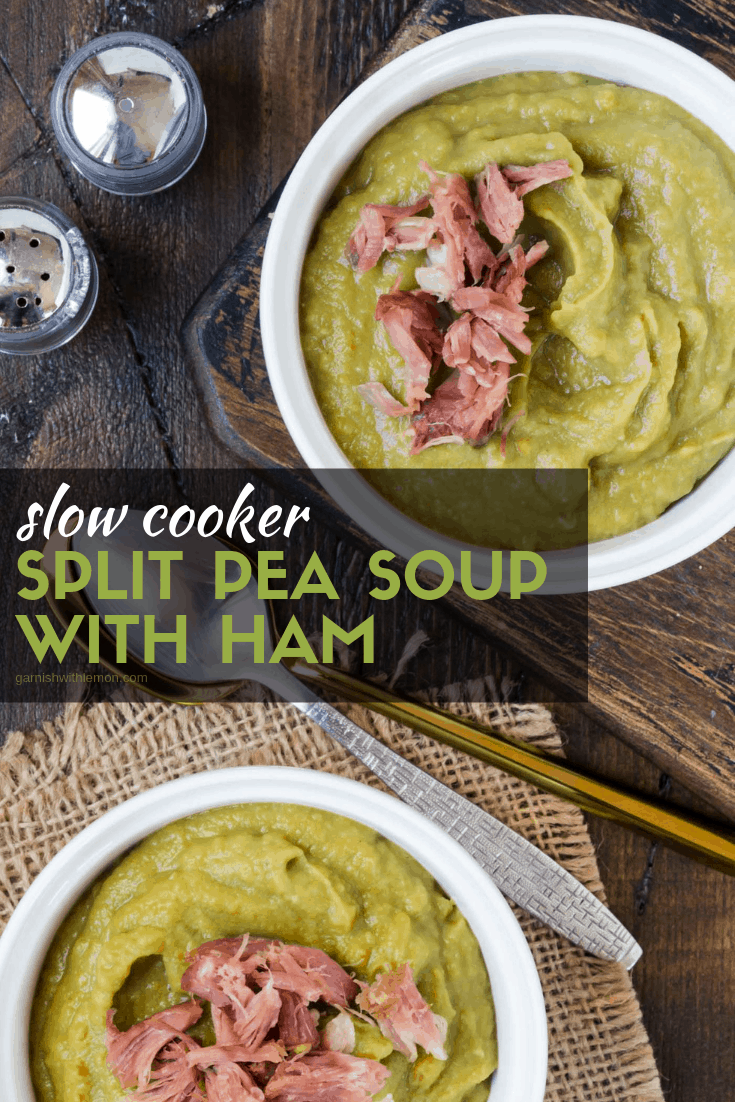 Two white bowls of Slow Cooker Split Pea Soup with Ham on a dark wood background. Garnished with extra ham.