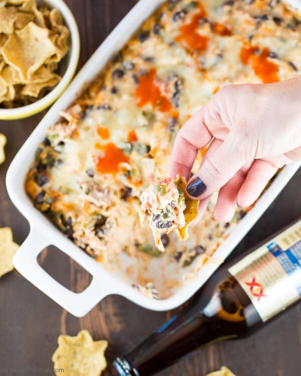 This make ahead, warm Cheesy Chile Chicken Dip recipe has just the right amount of heat to leave your guests scrambling for more.