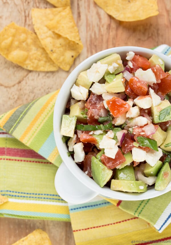 This Avocado Feta Salsa is one of the most requested recipes from my kitchen! Filled with tomatoes, feta and fresh avocado, it's guaranteed to disappear!