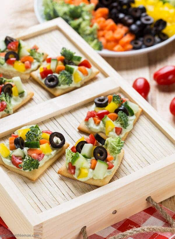 These Avocado Ranch Veggie Pizza Bites - made with protein-rich Greek Yogurt - are a delicious way to load up on your vegetables!