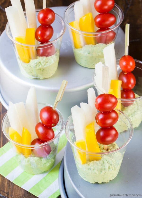 Creamy goat cheese pesto dip garnish with lemon for Summer food party ideas