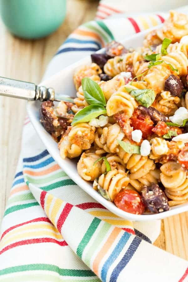 Tomato Feta Pasta Salad Recipe: This crowd-pleaser is packed with sun-dried tomatoes, feta cheese and kalamata olives in every spoonful.
