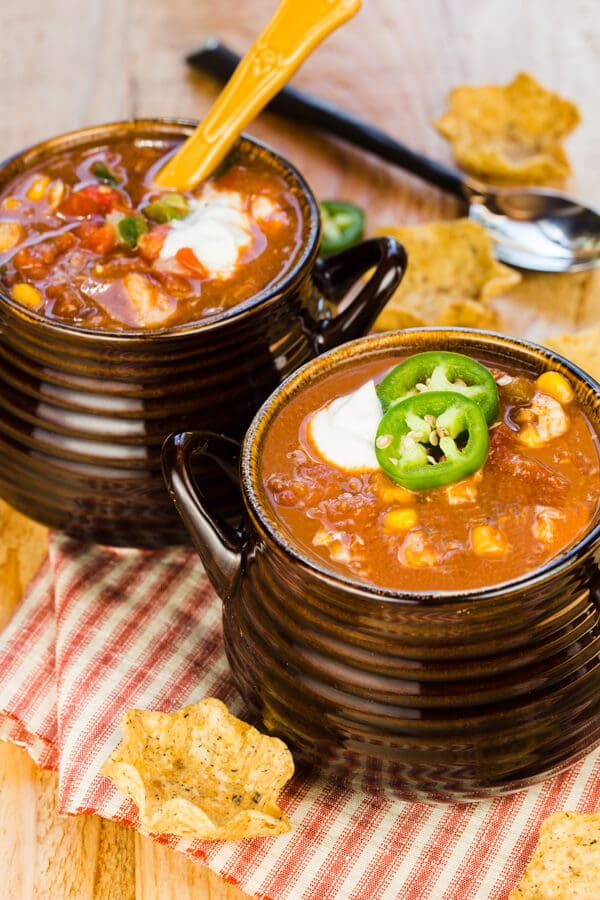 Slow Cooker Chicken Taco Soup is an easy dinner made with pantry staple ingredients. Chop, dump, pour and let the slow cooker do the work for you!