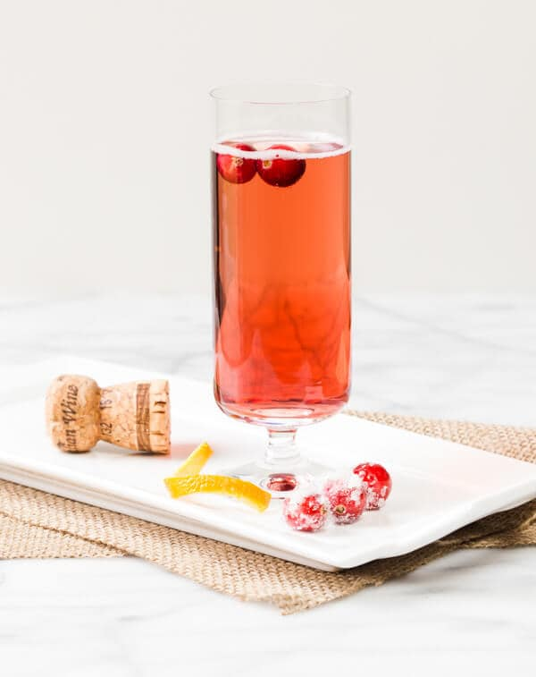 Bubbles add instant sparkle to a drink. This Cranberry Orange Prosecco Cocktail is a tasty way to toast friends and family.