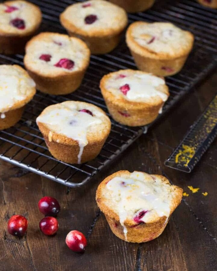 Bursting with cranberries and finished with an orange glaze, these Glazed Cranberry Orange Muffins are the perfect sweet to add to your holiday brunches.