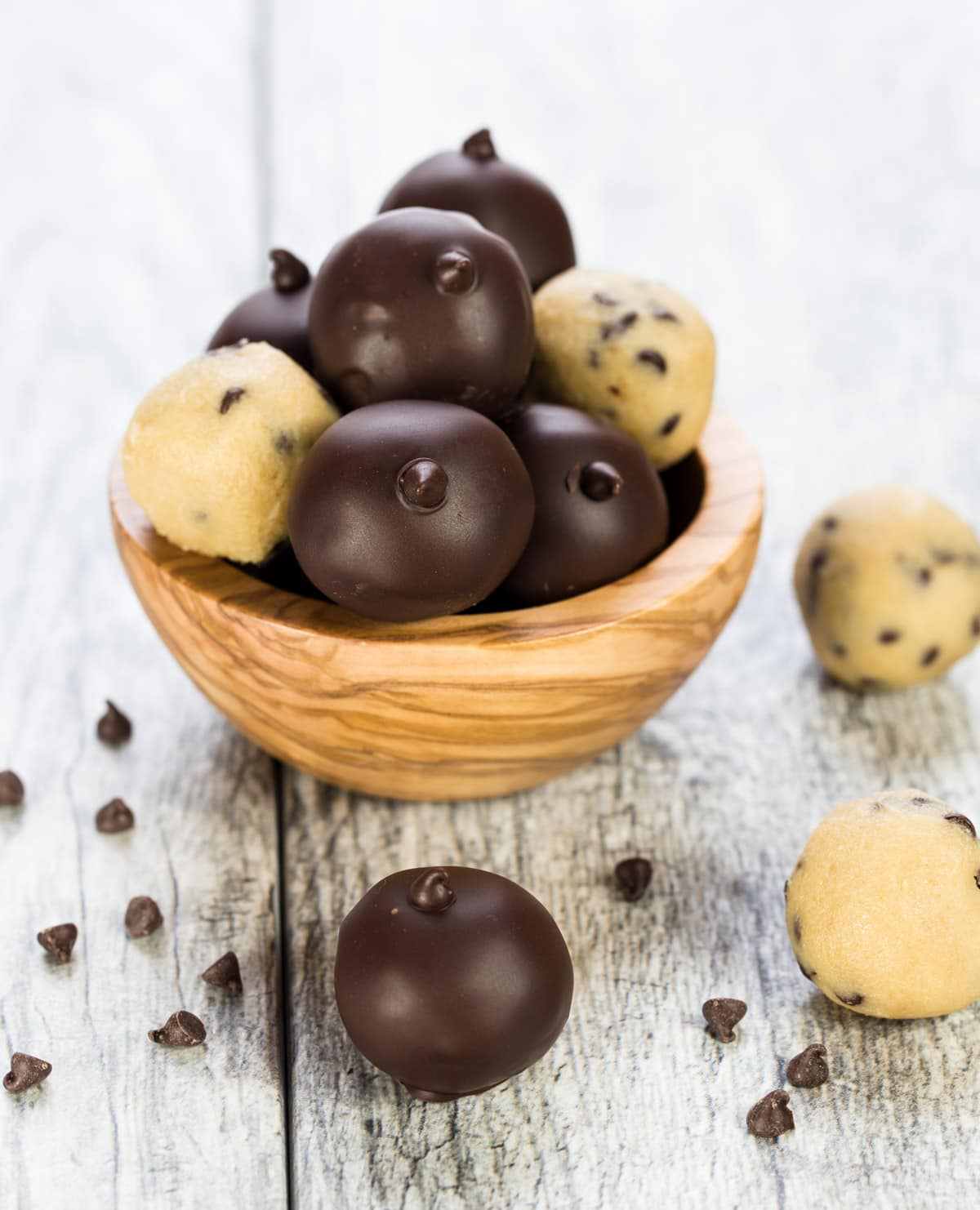 Wooden bowl filled with Chocolate Chip Cookie Dough Truffles.