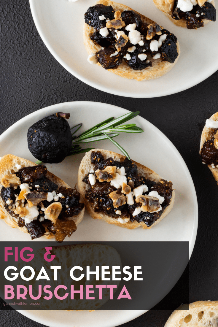 Small white plates filled with Fig and Goat Cheese Bruschetta.