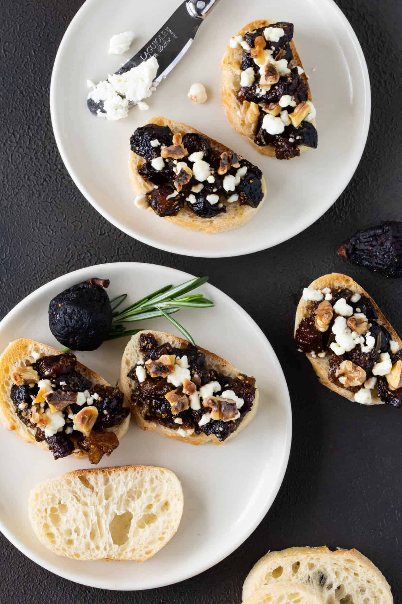 Fig and Goat Cheese Bruschetta on small white plates.