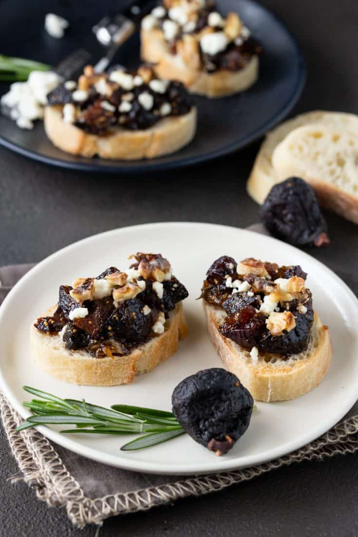 Small plates of Fig and Goat Cheese Bruschetta.