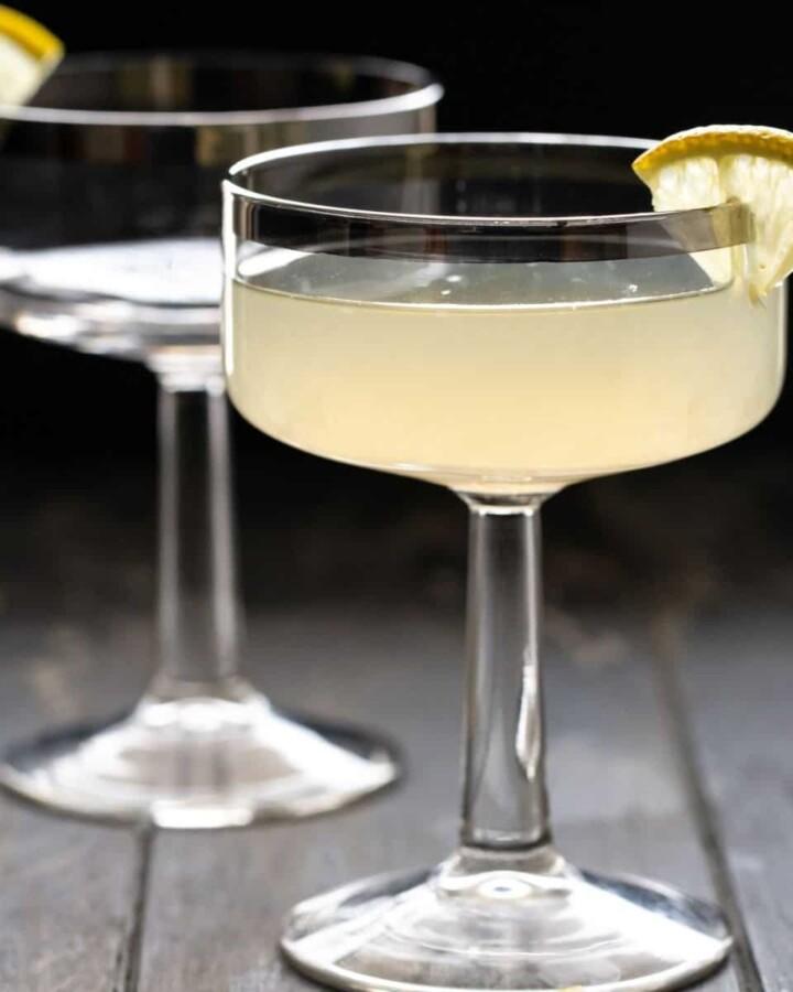 Ginger pear martini in a martini glass with lemon garnish.