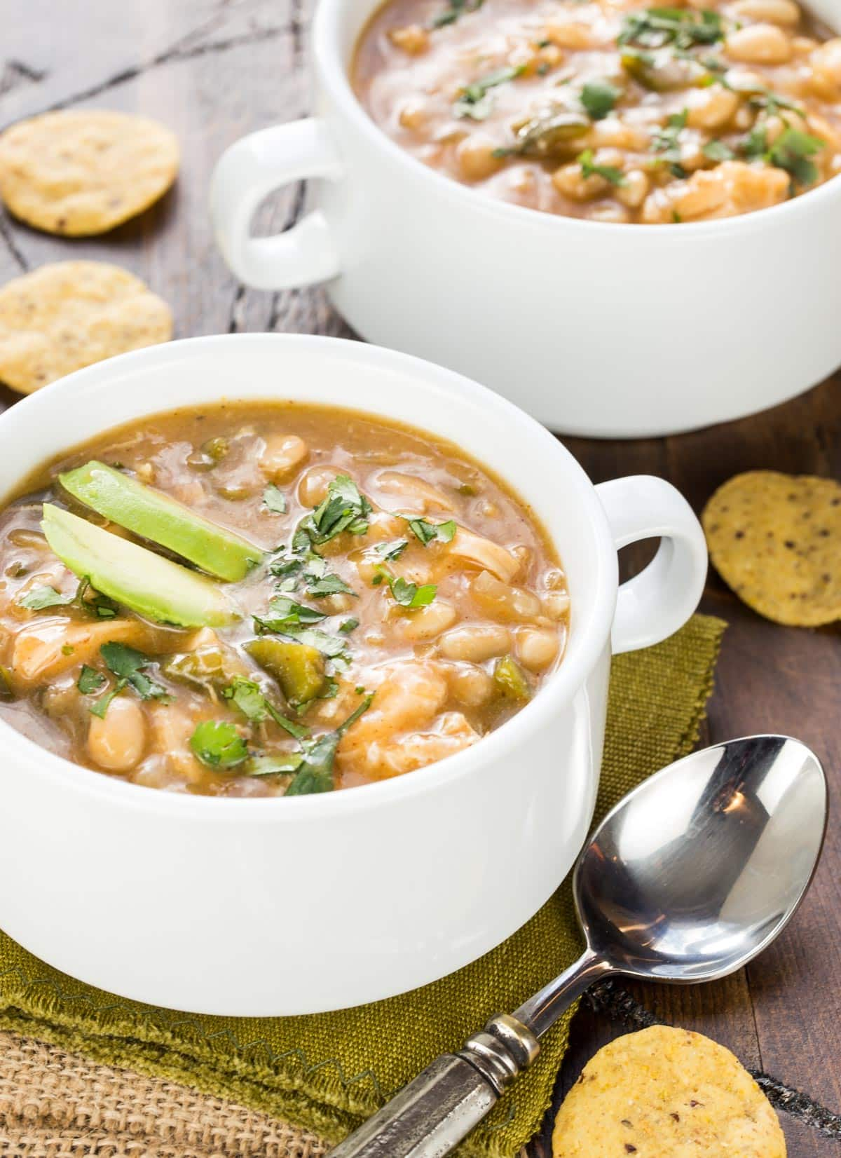 Filled with flavors of the southwest, this Slow Cooker White Chicken Chili recipe is a delicious addition to any winter gathering!