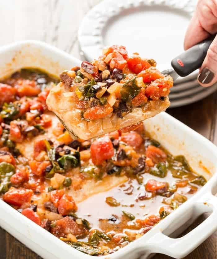 Baked mahi mahi with tomatoes olives garnish with lemon for Simple baked fish recipes