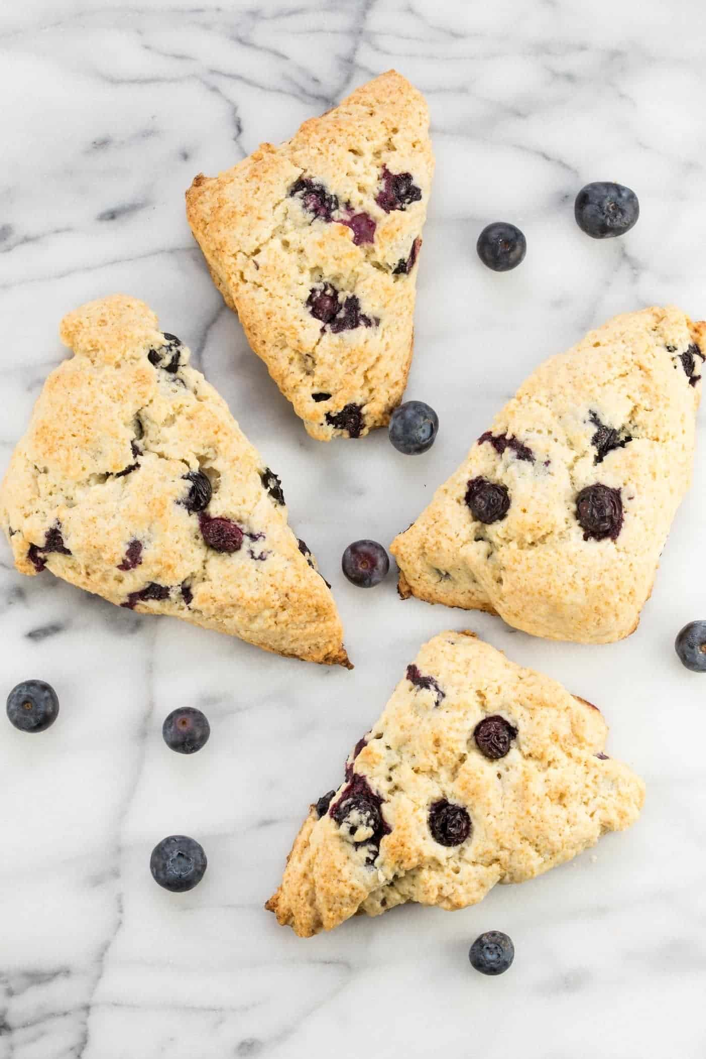Just say NO to dry and crumbly scones! Bursting with fresh berries, these Blueberry Scones are an easy breakfast treat that will have you fall in love with scones all over again!