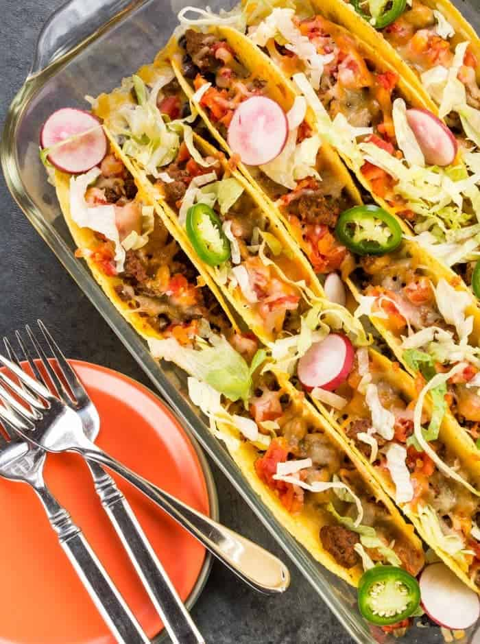 Need dinner in a hurry? 30 minutes is all you need to pull together this crowd-pleasing recipe for Oven Baked Beef Tacos!