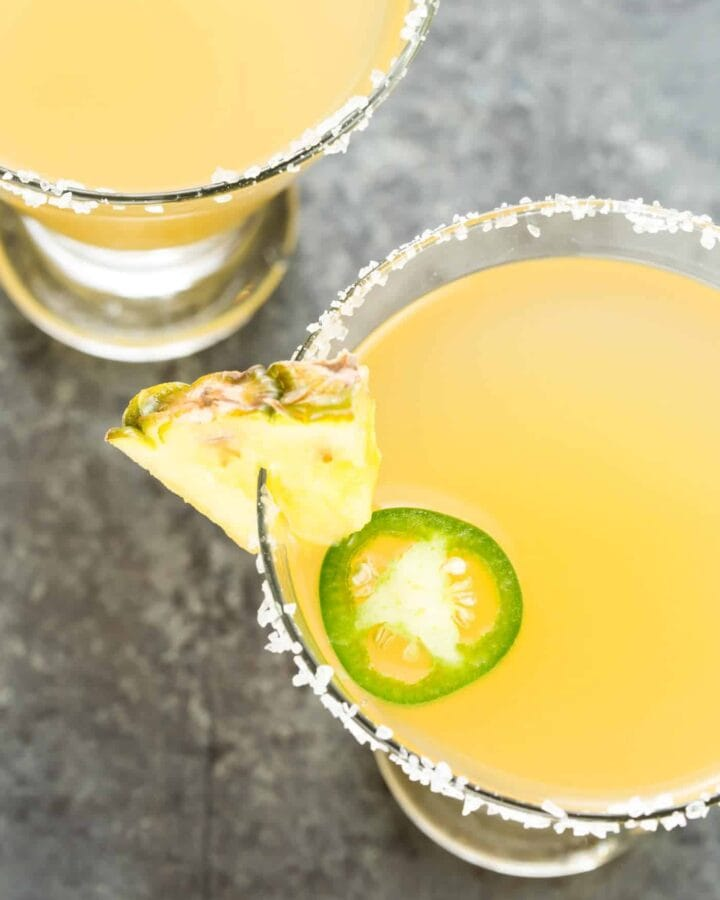 Nobody will mess with this Texas Margarita! Enjoy the twist on the traditional margarita with pineapple juice and a little spice from a jalapeno pepper!