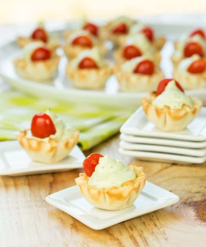 Need a last minute appetizer? These 4 ingredient Pesto Bites come together in minutes and are perfect bite size snacks for any party!