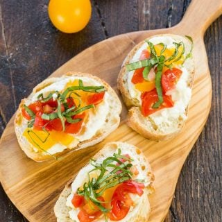 Filled with flavors from the garden, this Crostini with Whipped Feta and Tomatoes is the appetizer that every summer gathering needs