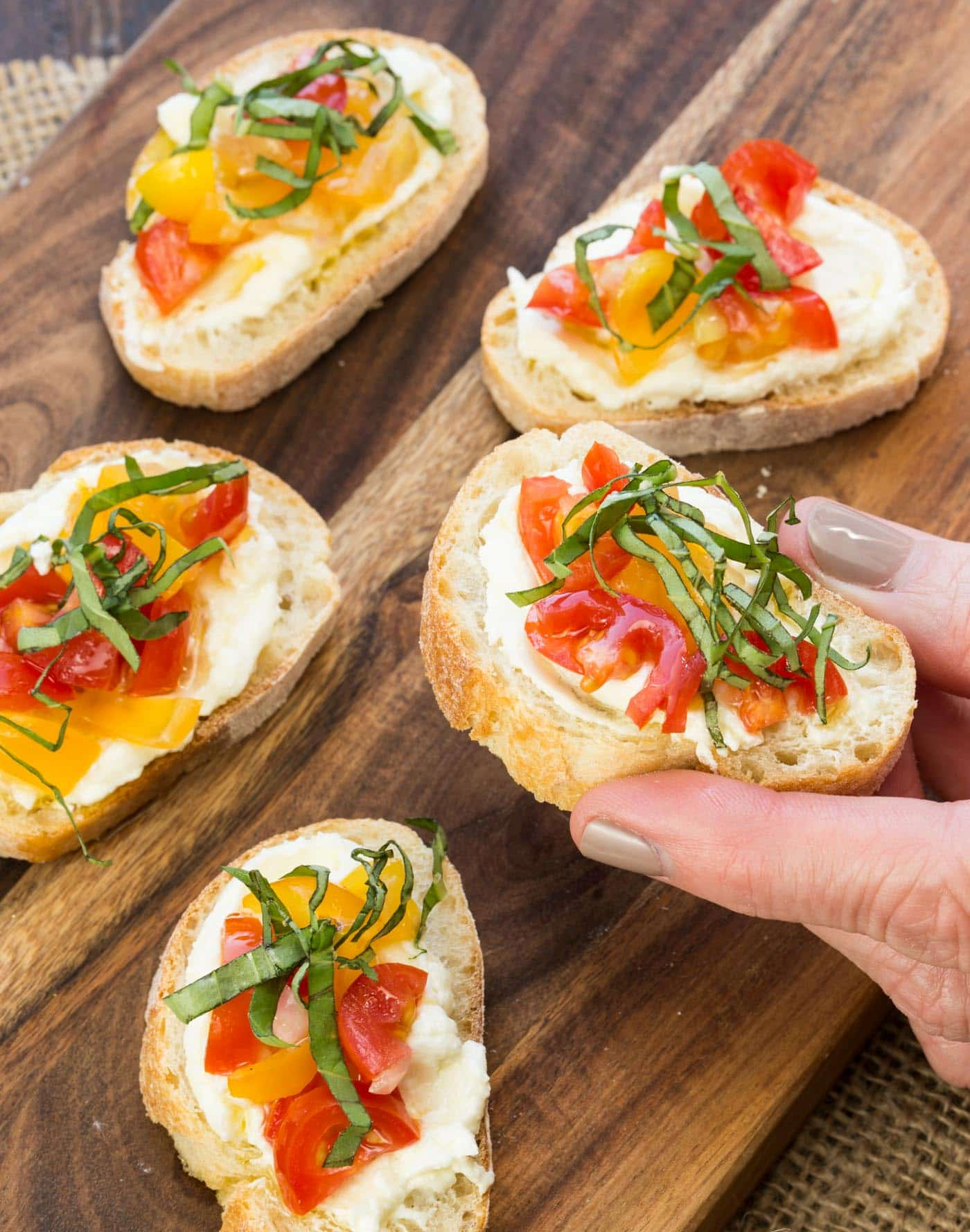 Whipped feta makes this crostini with tomatoes something special.