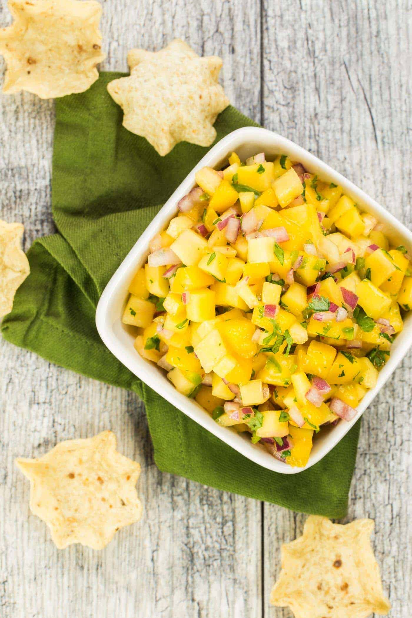 This flavor packed, 4 ingredient Mango Salsa is the perfect partner with chips or is a tasty topping for fish and chicken.