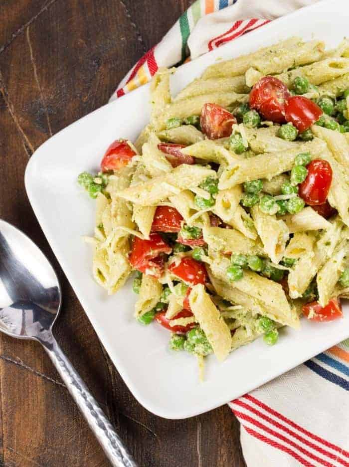 This Pesto Pasta Salad with Peas filled with tomatoes and pine nuts is the perfect side dish to anything that comes off the grill.