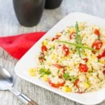 This Quinoa Salad recipe filled with Corn, Tomato and Cotija Cheese is a protein filled side that is our family's favorite side dish!