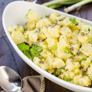 Filled with capers, onions and a light olive oil dressing, this Danish Potato Salad is our family's favorite potato salad!