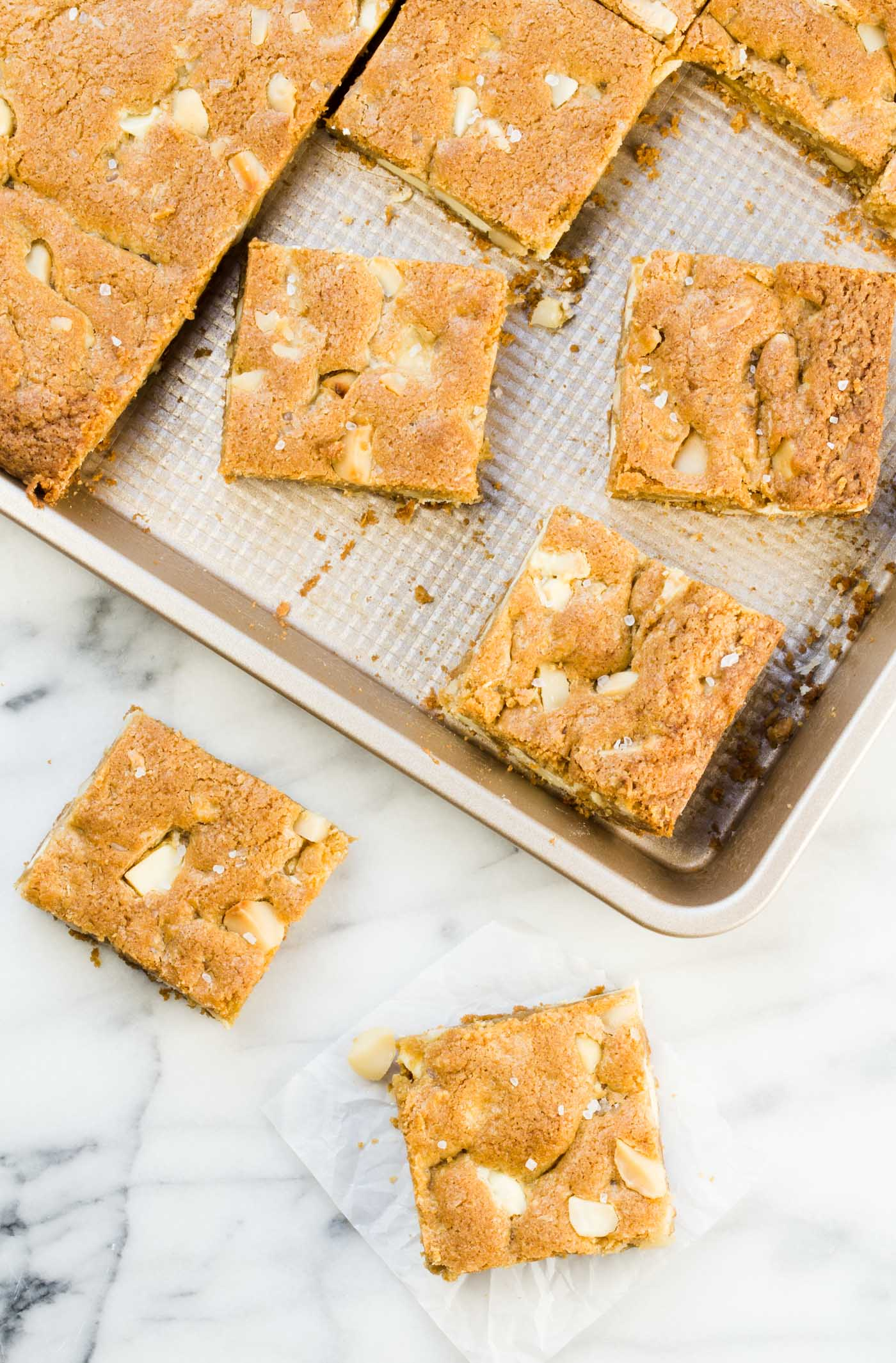 Change up your cookie craving with a pan of these White Chocolate Macadamia Nut Cookie Bars - a quick and easy dessert recipe for potlucks and picnics!