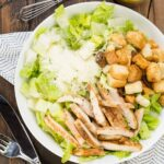 Filled with parmesan, garlic and juicy chicken, this Grilled Chicken Caesar Salad with homemade dressing is a hit with the whole family!