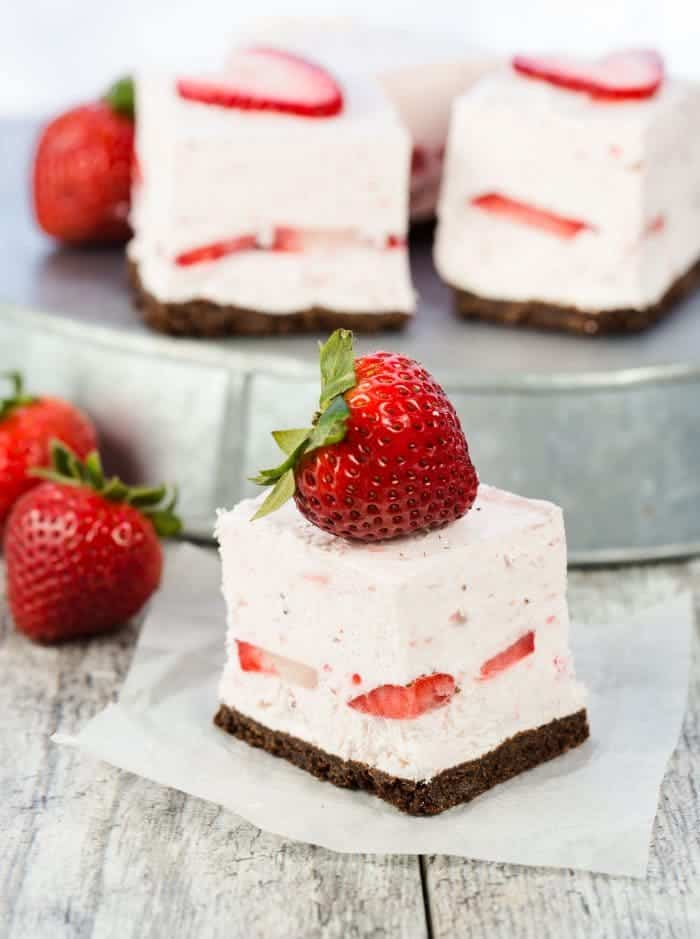 Sweet, creamy and filled with strawberries in each bite, these No Bake Strawberry Cheesecake Bars are the perfect sweet treat for any summer meal!