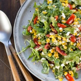 Make the most of summer's fresh sweet corn with this mouthwatering Arugula Goat Cheese Corn Salad!