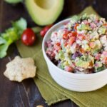 Avocado Feta Salsa is always the first to disappear at a party! Filled with fresh avocado, tomatoes and feta cheese you can not go wrong!