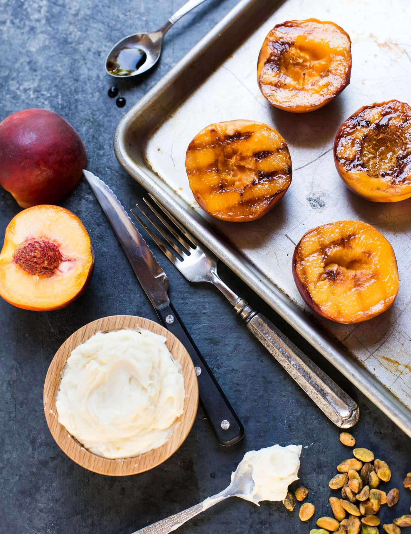 You'll want to keep the grill going for dessert. These juicy Grilled Peaches with Mascarpone, Pistachios and Balsamic Glaze are the perfect sweet ending to any summer BBQ!