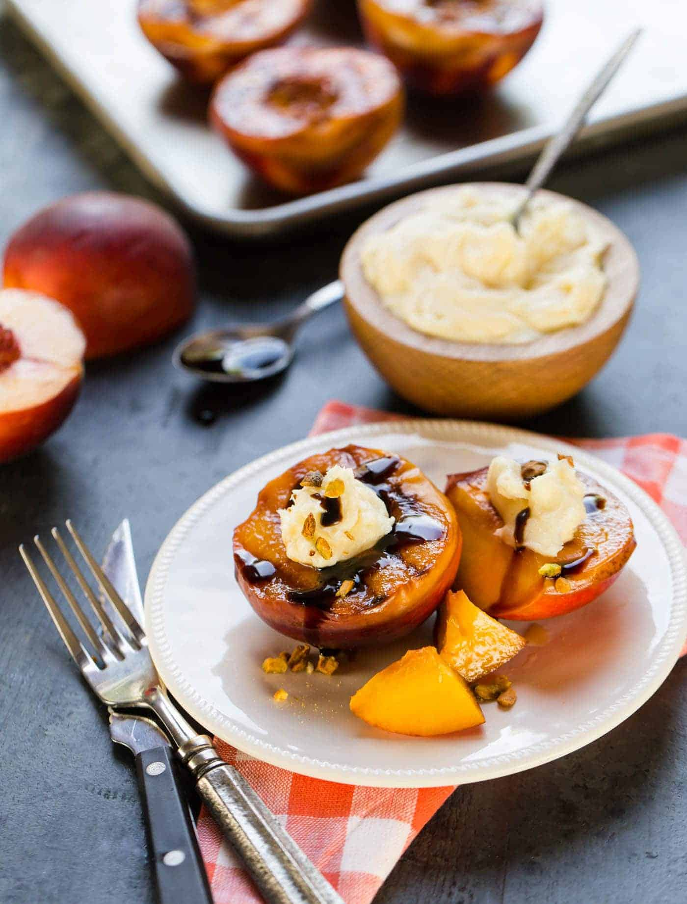Grilling fruit brings out its natural sweetness, and these quick and easy Grilled Peaches with Mascarpone, Pistachios and Balsamic Glaze is a delicious way to end a summer BBQ!