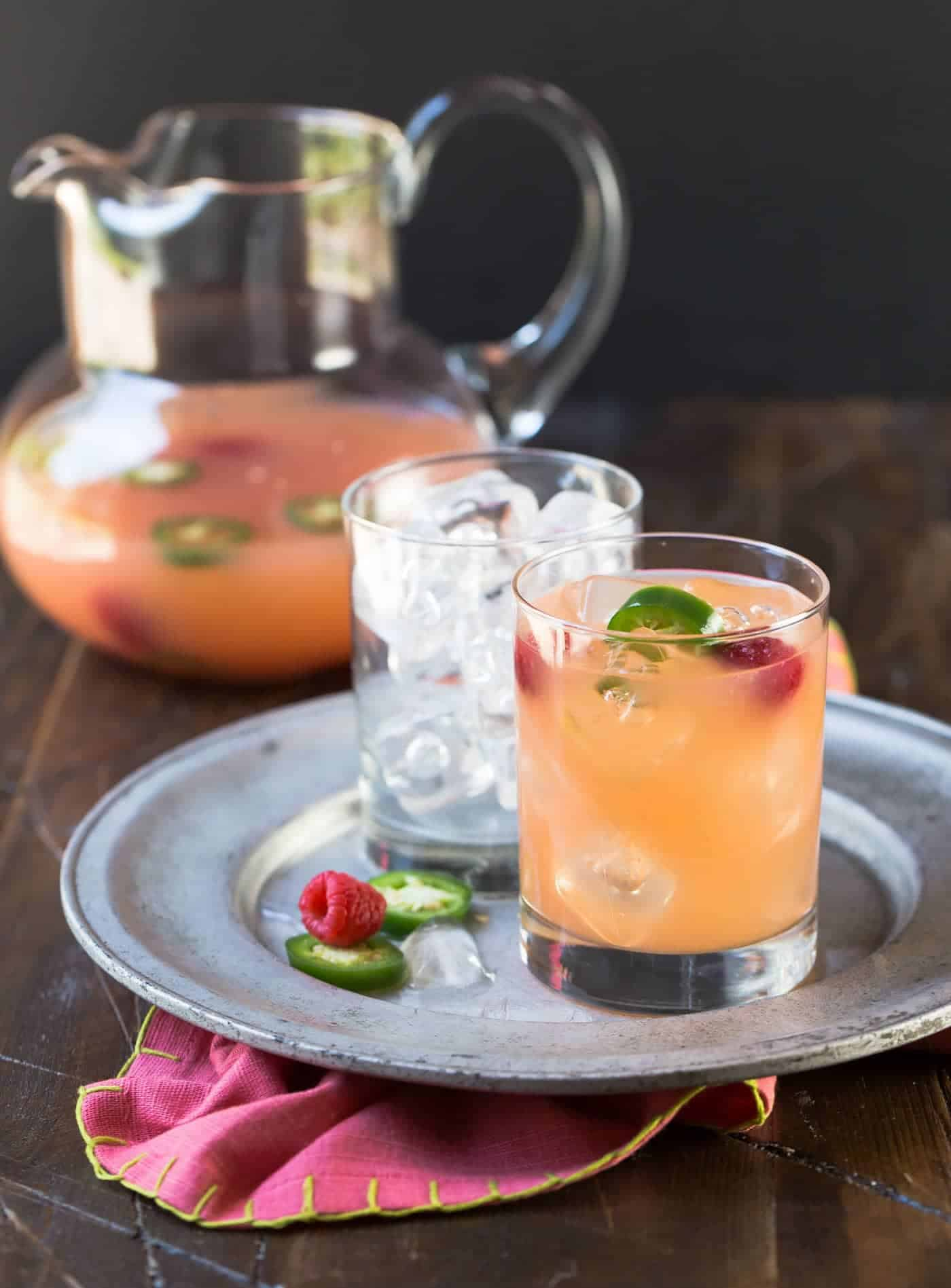 Straight on image of Raspberry Paloma cocktails on a silver tray.