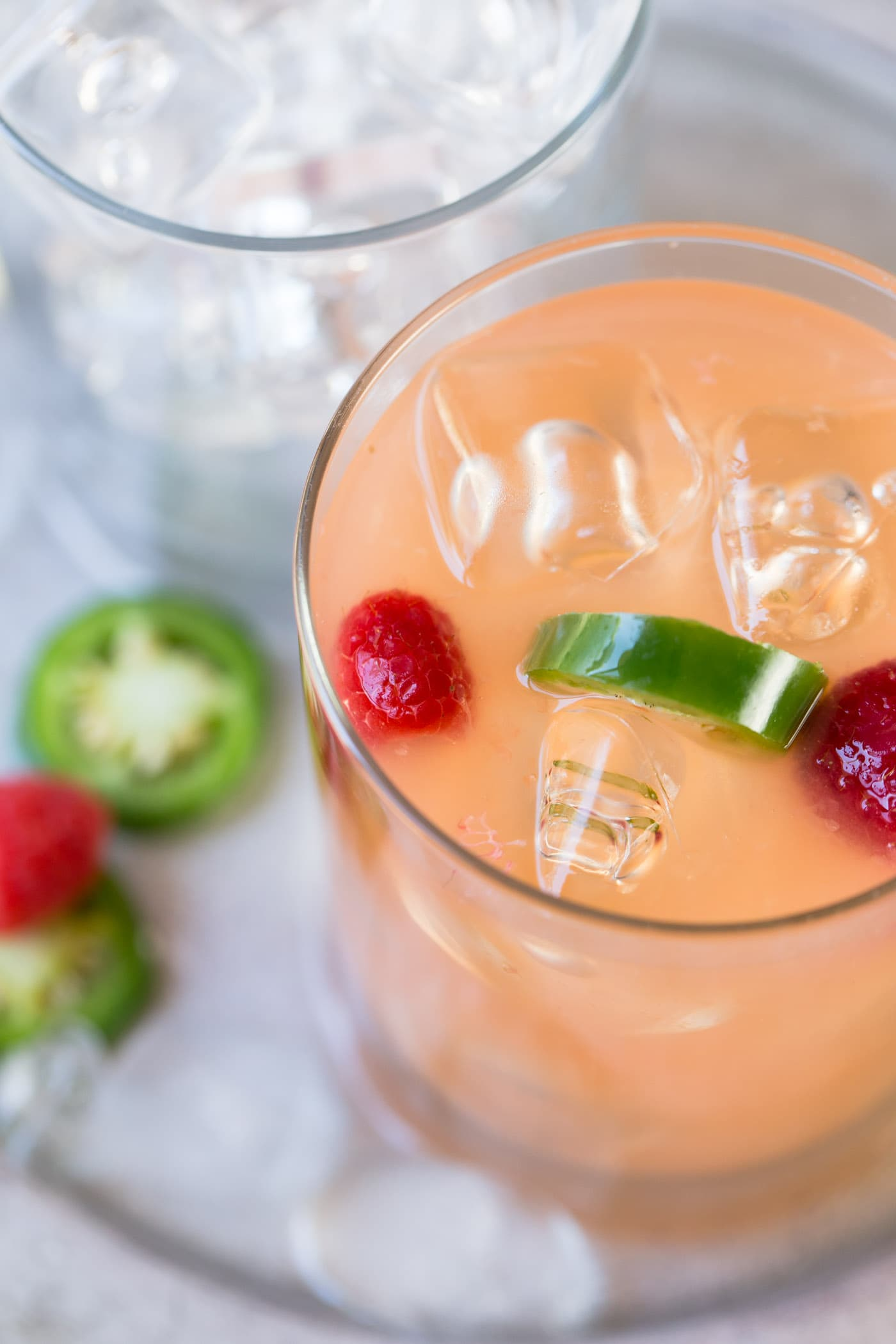 Take your love of tequila beyond the margarita with these refreshing Raspberry Palomas, a delicious tequila cocktail made with citrus juices, raspberries and a hit of heat from jalapenos.