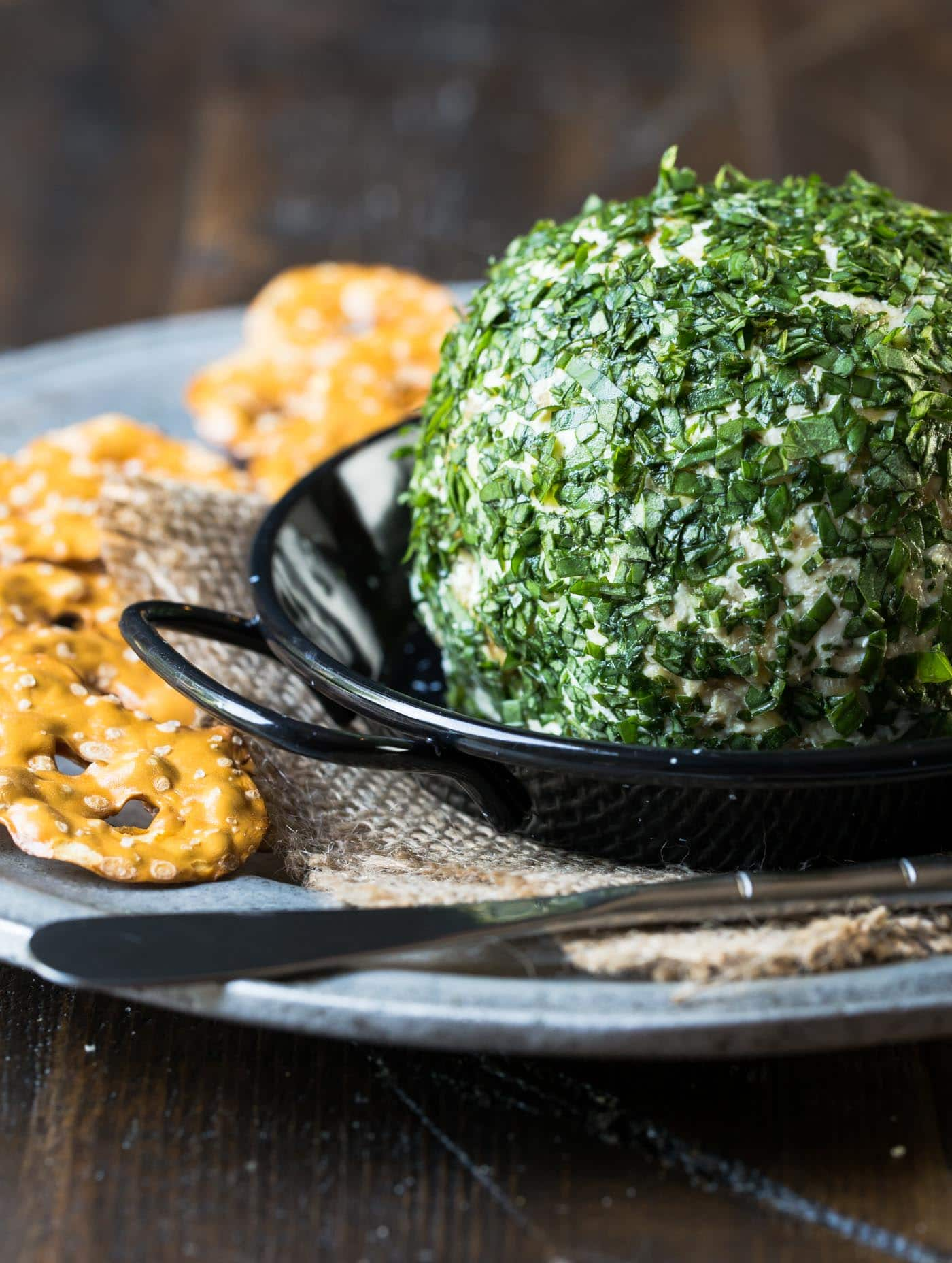 Caramelized Vidalia onions are the key to this rich and flavorful Goat Cheese, Basil & Vidalia Onion Cheese Ball - a crowd pleasing appetizer for everyone!