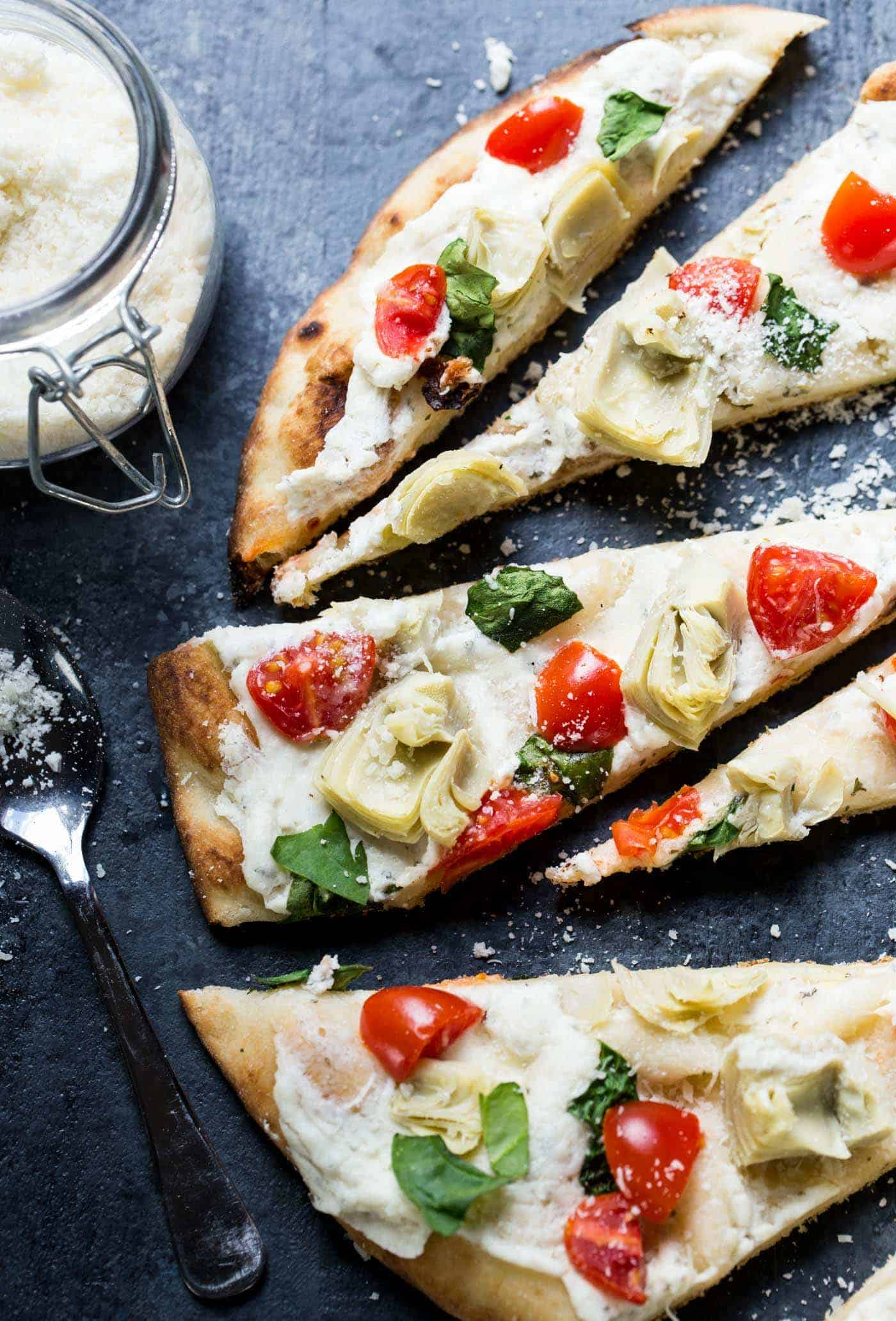 6 ingredients and a quick spin on the grill (or the oven) is all it takes to make this simple and crazy good Grilled Vegetable Flatbread Pizza. Enjoy it as an easy appetizer or light dinner!