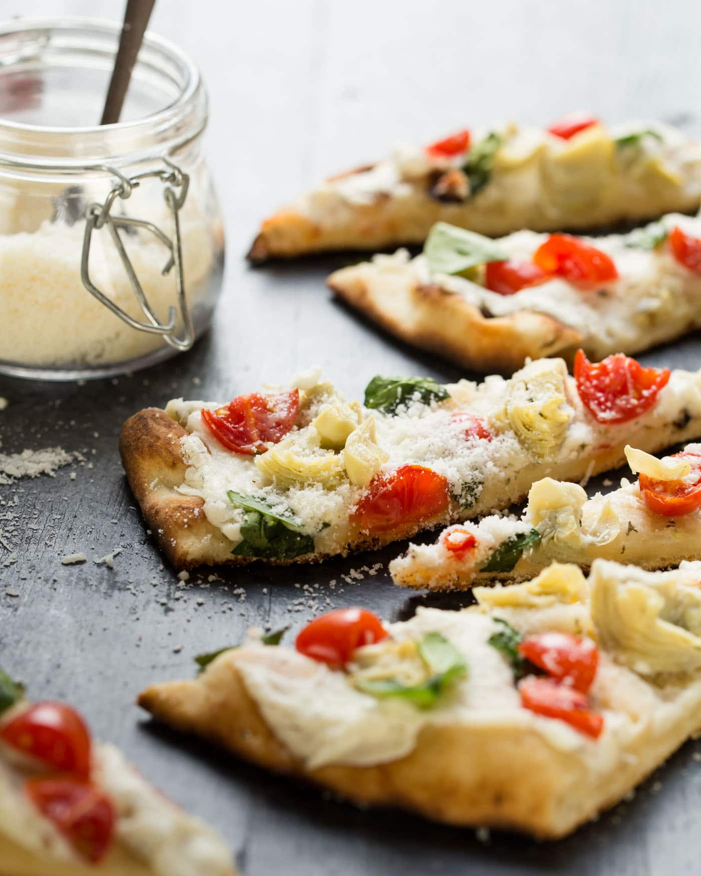 This quick and easy Grilled Vegetable Flatbread Pizza can be on the table in minutes using a few of my favorite supermarket shortcuts. Just as tasty hot or at room temperature!