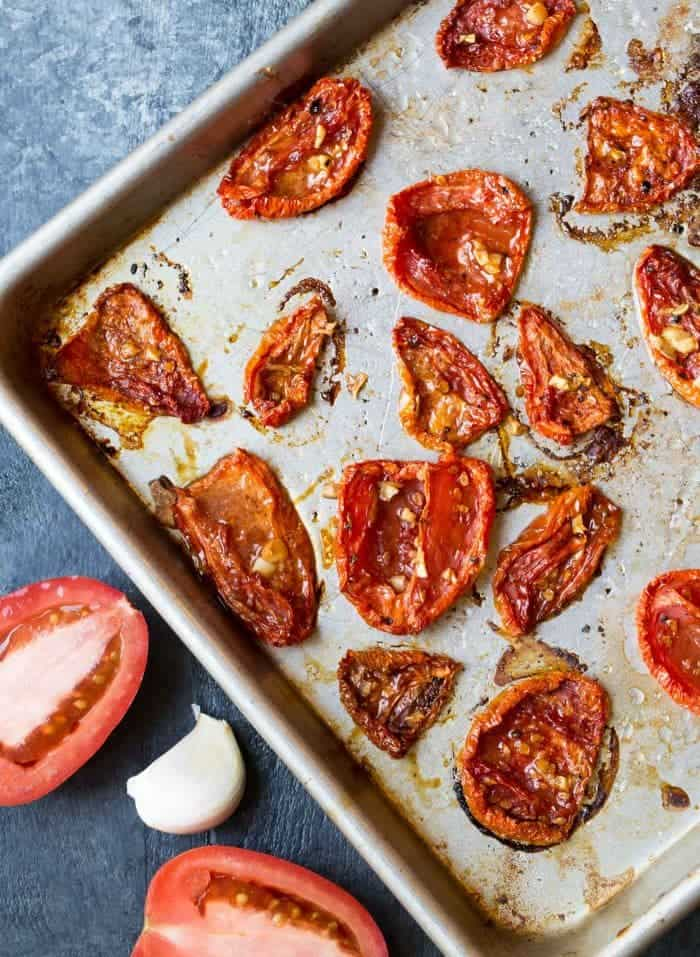 Oven Roasted Tomatoes are a tasty way to hang onto summer. Nothing makes a tomato sweeter than giving it a long roast in the oven.