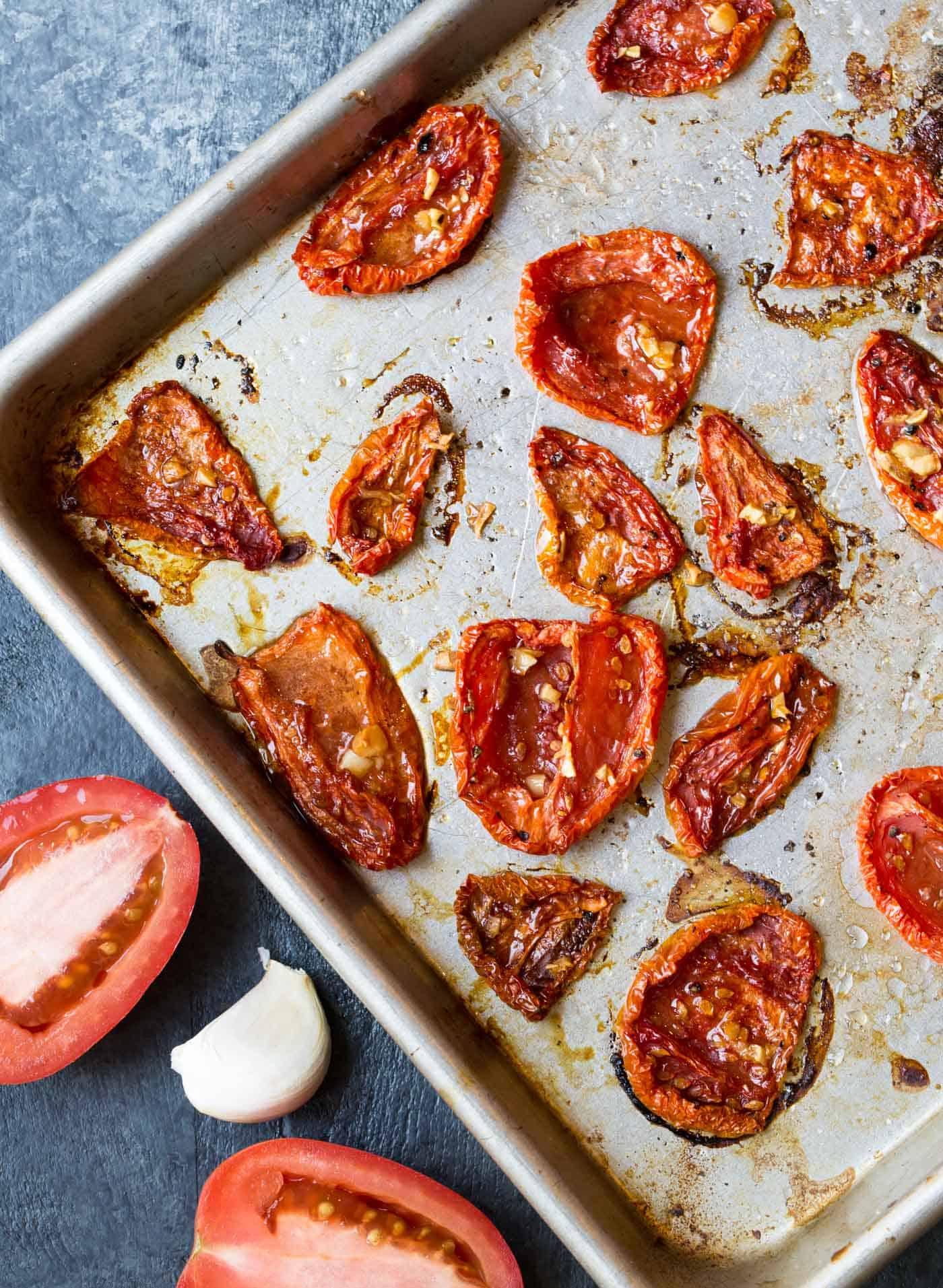 Roasted tomatoes on sheet pan.