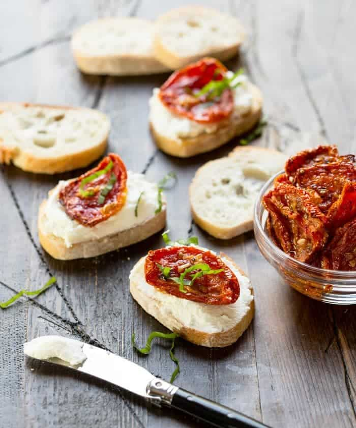 Top a baguette with warm goat cheese and oven roasted tomatoes for an easy appetizer!